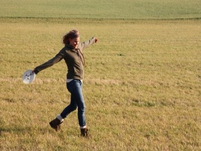 woman hiking in fields featured