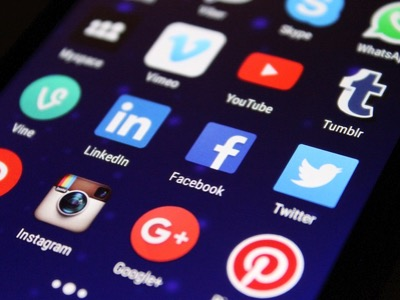 A phone with popular social media apps, such as Twitter, Facebook, Pinterest and Instagram