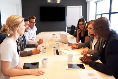 group of people meeting in a boardroom, sales meeting