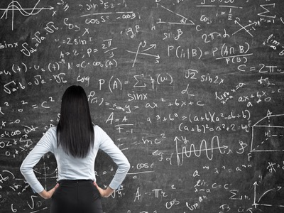 woman looking at a board of mathematics featured