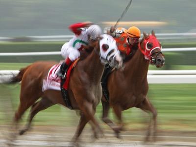 female-jockeys-riding-in-a-race-featured