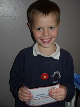 Kyler Holding His Star Of The Week Certificate
