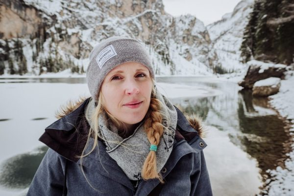 Editor of We Are The Wanderers Cat Ekkelboom-White at Lake Prags in the Dolomites in Winter