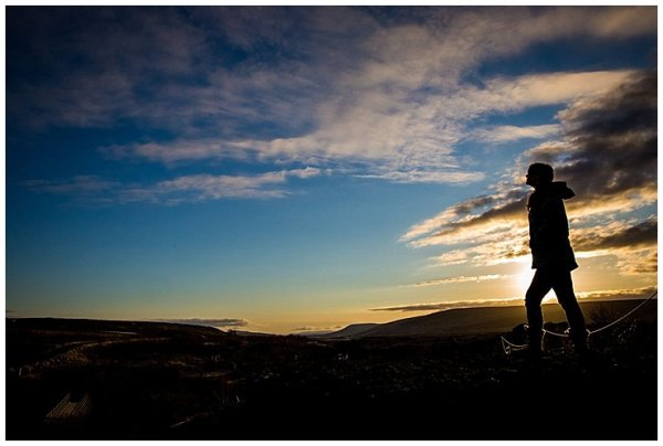 A person stands silhouetted in Iceland at sunset