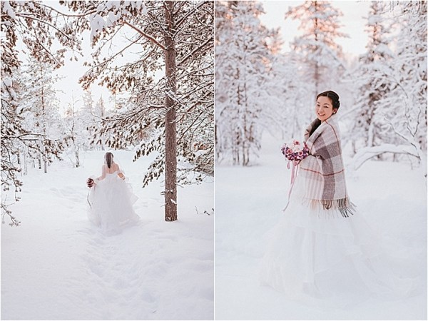 The bride walks out in to the snow in a white wedding dress with a tartan rug to keep her warm for her Finland wedding photos by Maria Hedengren Photography