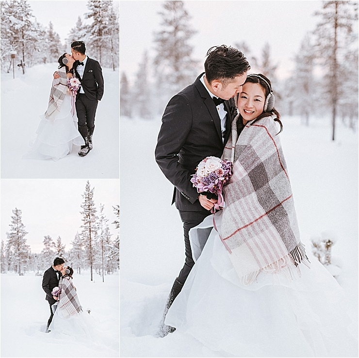 The bride and groom walk through the deep snow in the forest and stop to kiss by Maria Hedengren Photography