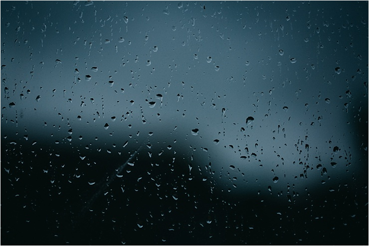 Raindrops on the window glass by Hannah Hall Photography