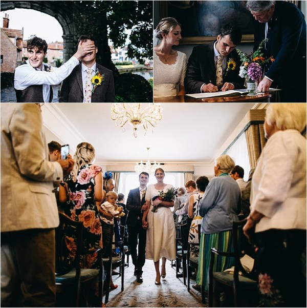 The bride and groom make their wedding official at the registry office by Hannah Hall Photography