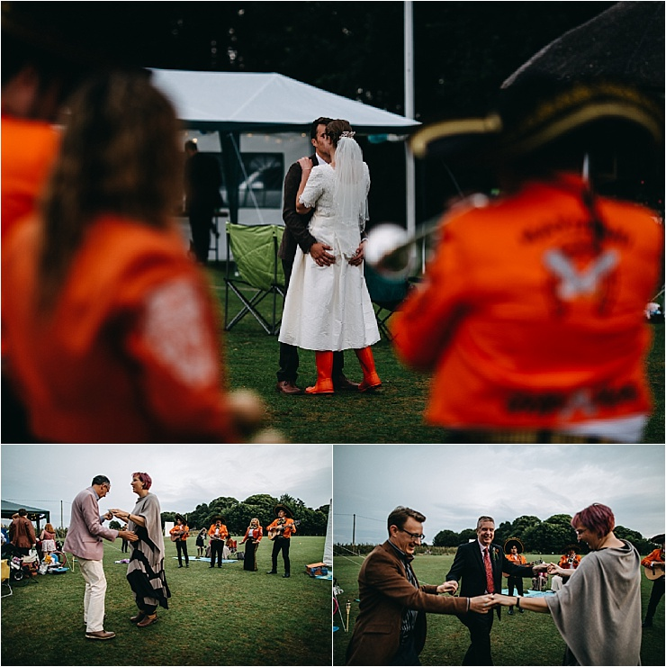 Guests dance to mariachi music at an english cricket club wedding by Hannah Hall Photography