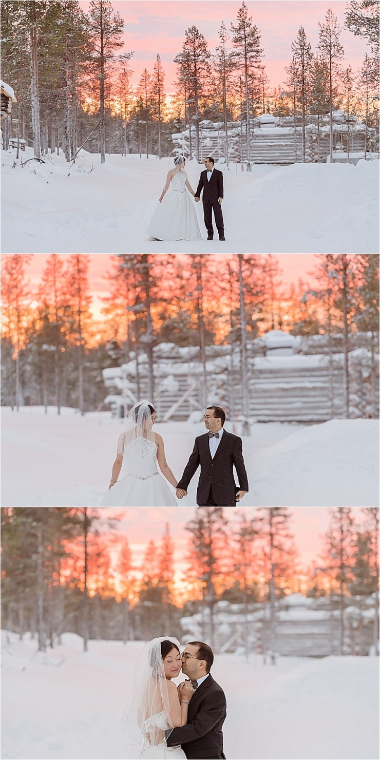 The bride and groom have portraits under the small amount of sun that rises during the arctic winter at Kakslauttanen arctic resort in Finland by Your Adventure Wedding