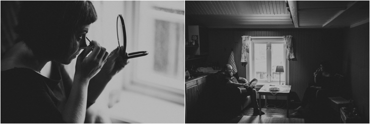Black and white photos of the bride doing her eye makeup by a window in Lofoten Norway by Thomas Stewart