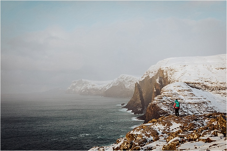 Hiking along the cliffs to Bosdalafossur waterfall in the Faroe Islands by We Are The Wanderers