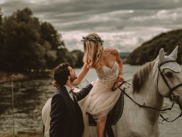 The bride leaves the wedding ceremony on horseback at Gasthaus Schupfen in Switzerland by Bring Me Somewhere Nice