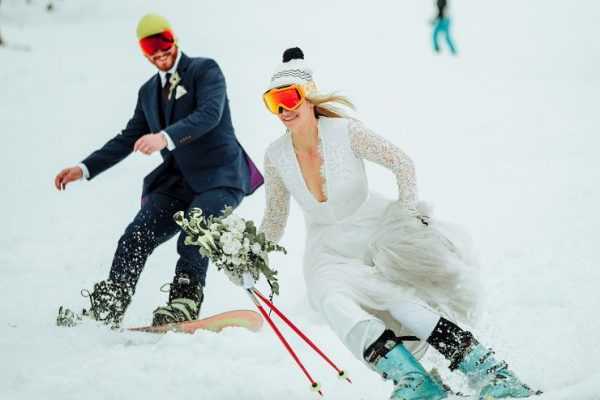 Bride and groom skiing at their Austrian wedding by Wild Connections Photography