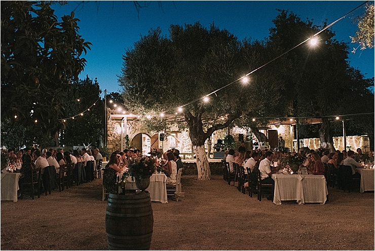Guests enjoy dinner at a winery in Crete by Andreas Markakis Photography