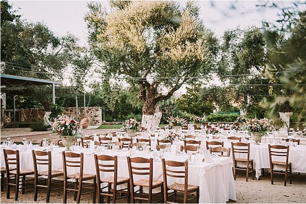 An outdoor winery wedding reception in Crete by Andreas Markakis Photography
