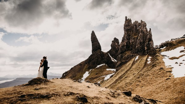 Bride and groom against a rocky backdrop by Unfurl Photography