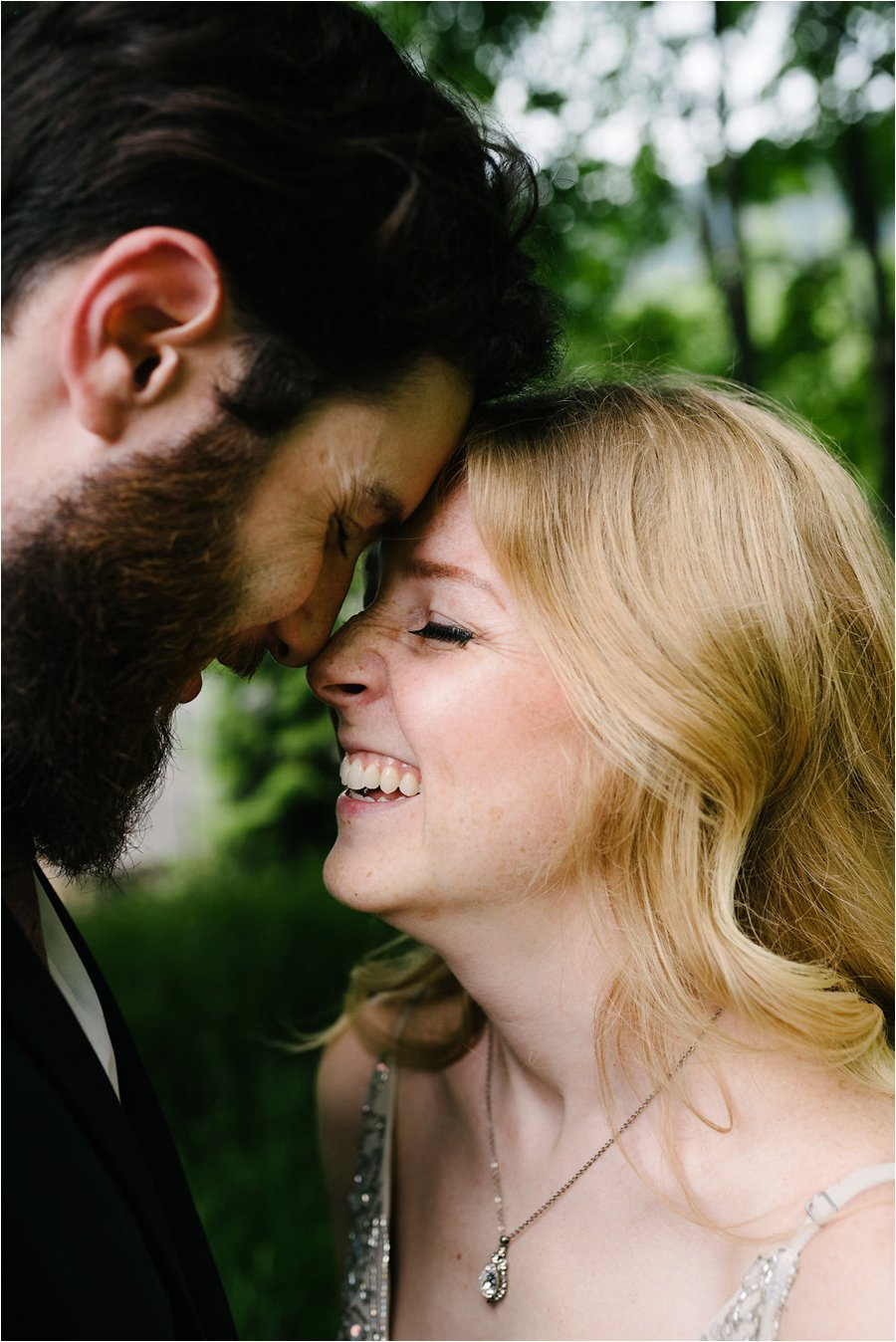 Bride & groom with their foreheads together and laughing - After wedding honeymoon shoot in Wengen by Caroline Hancox Photography