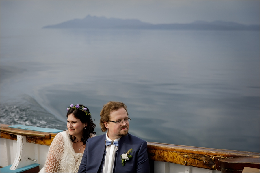 Tina & Jürgen on the boat to their Loch Coruisk Elopement On The Isle Of Skye by Lynne Kennedy Photography
