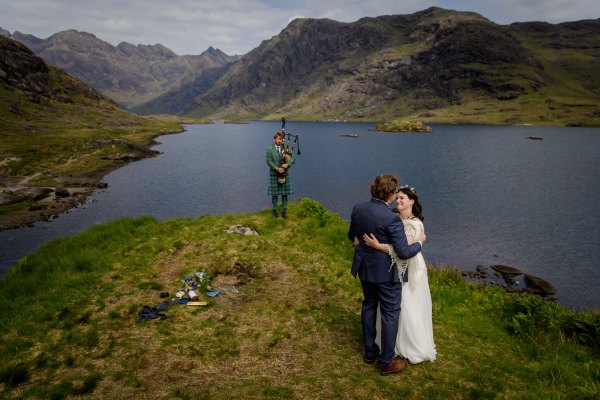 The bagpipes play as Tina & Jürgen dance their first dance by Lynne Kennedy Photography