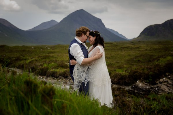 Tina & Jürgen stand head to head on the Isle of Skye in Scotland by Lynne Kennedy Photography