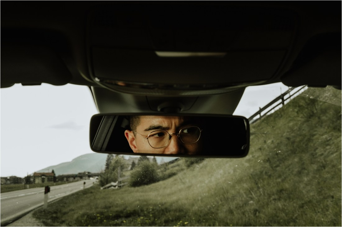 A view of Ted in the mirror of the car by Wild Connections Photography