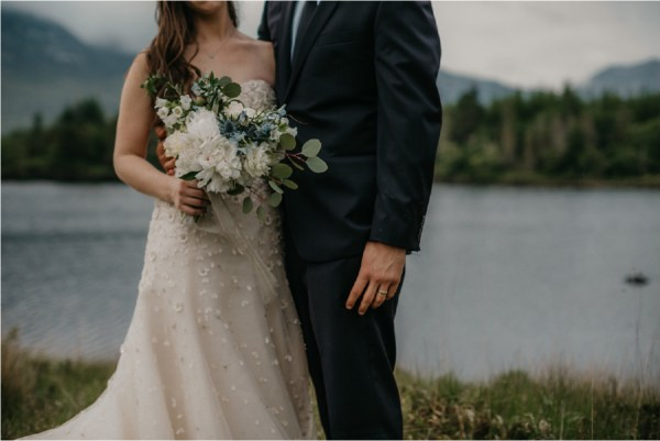 Detail shot of the bride holding the bouquet at Ballynahinch Castle by No Other Love Photography