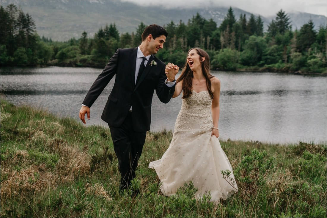 A laughing bride and groom turn to each other and smile after their intimate destination wedding in County Galway by No Other Love Photography