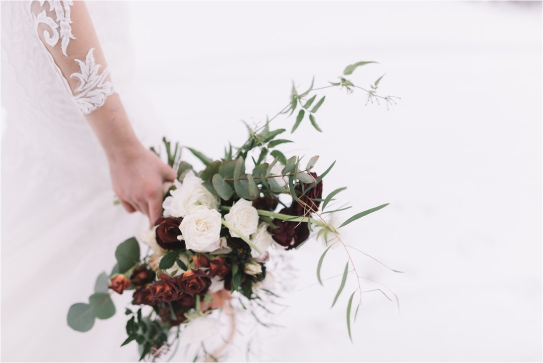 A winter wedding bouquet for a snowy Finland wedding by Lucie Watson Photography