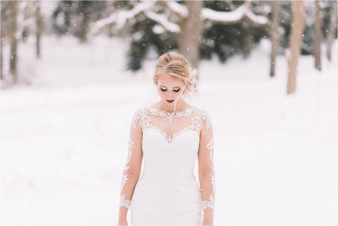 A bridal portrait in the snow by Lucie Watson Photography