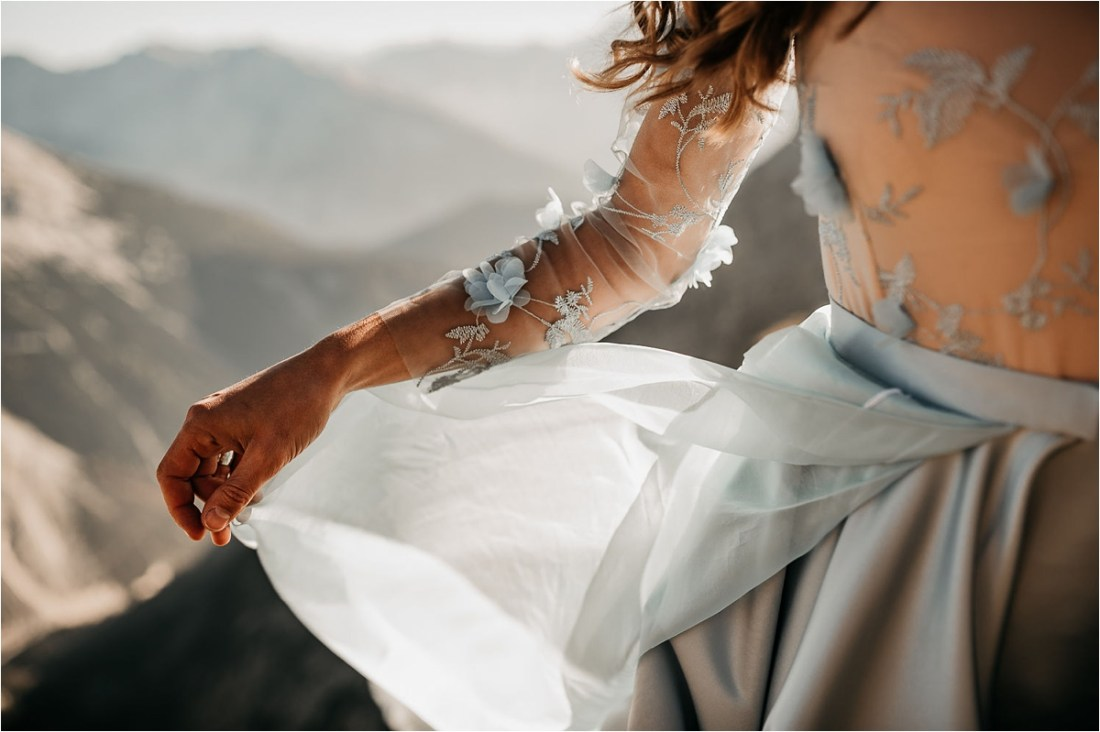 Bride waves her blue dress in the wind by Aneta Lehotska
