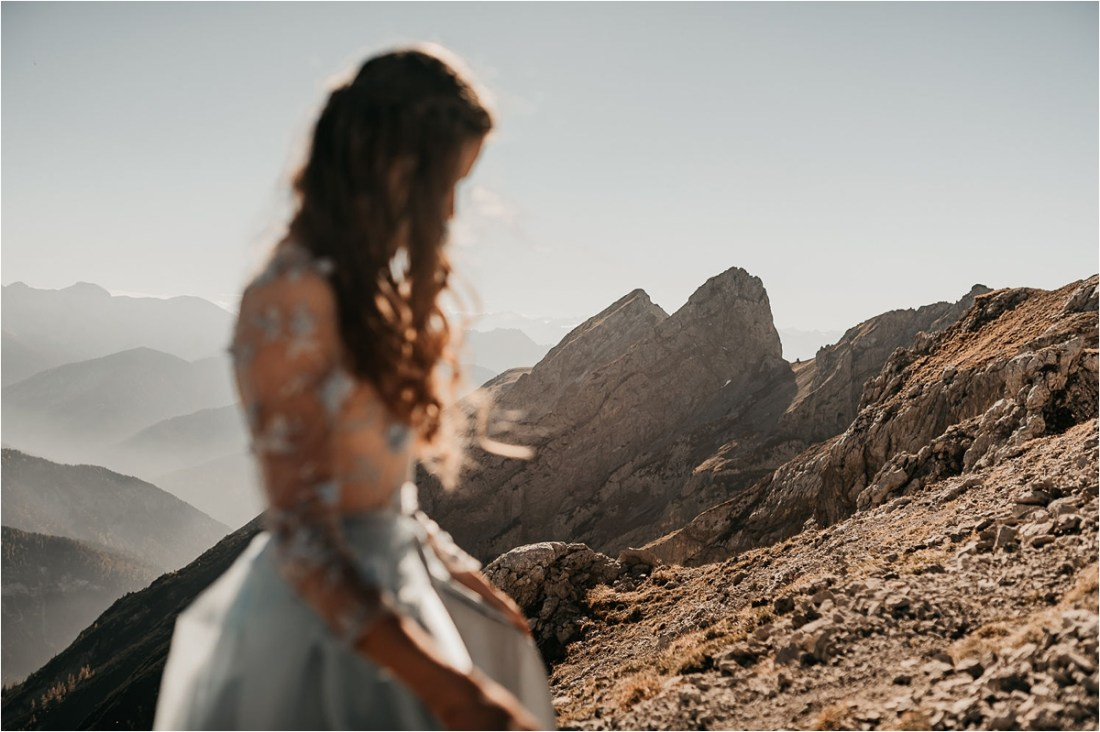 The bride on a mountain in a blue dress by Aneta Lehotska