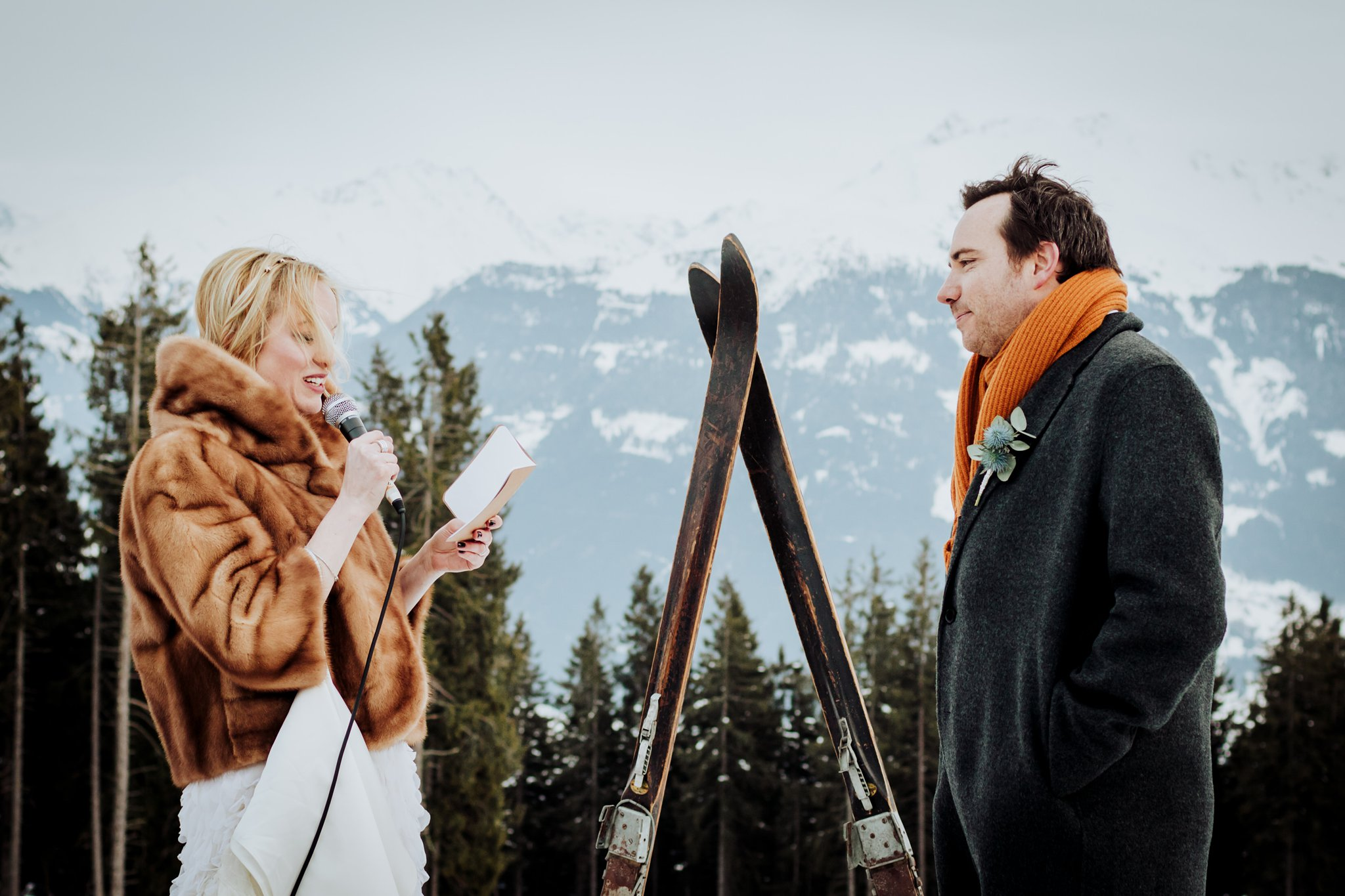 An outdoor winter wedding ceremony in an Austrian Ski resort by Wild Connections Photography
