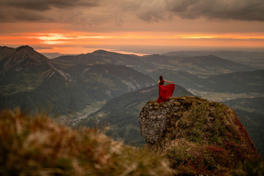 Girl in red dress on Kanisfluh Mountain in Austria