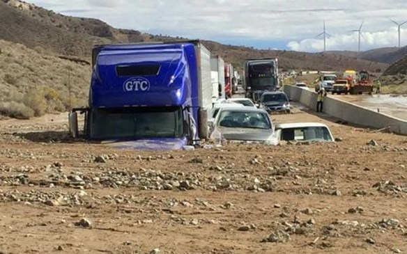 Vehicles stuck in the mud along California's Rt. 58. Credit: Caltrans/EPA