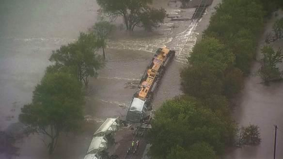 Credit: NBC Train derailed by flood waters near Dallas, TX