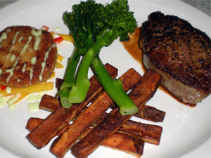 Seared Filet Mignon w/ pan jus, Crab Cakes w/ wasabi cream and Pepper Salad, Steak Fries and Steamed Broccolini.