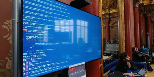 Some code displayed on the giant screen of the Paris workplace during the MDN Paris Event