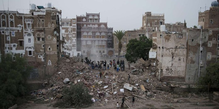 Rescuers, mostly neighbors and local men, attempt to dig a family out of a collapsed home after a Saudi-led arirstrike in the old city of Sanaa, Yemen on Friday, June 12, 2015. (AP Photo/Alex Potter)/CAIMA101/818291956095/1506121249