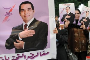 Tunisian women hold portraits of Tunisian President Zine El-Abidine Ben Ali, as they parade on Habib bourguiba avenue on November 7, 2009 in Tunis during a rally organized for the 22th anniversary of Ben Ali's arrival in office. Ben Ali was re-elected with 89.6 percent of the vote for a fifth term after two decades in power last month. AFP PHOTO FETHI BELAID