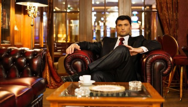 Man in expensive suit in luxurious room