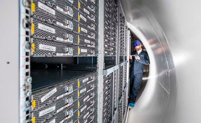 Team members from Microsoft inspect servers inside the Project Natick undersea server module at Nigg Energy Park in Inverness, Scotland. (Photo: Microsoft)