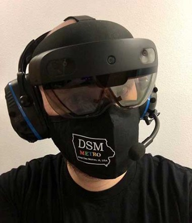 A staffer at Microsoft's West Des Moines data center campus with a HoloLens 2 equipped with headphones and microphone. (Image: Microsoft)