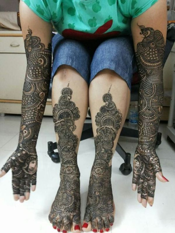 25. Mangoes and flowers Bridal Full hand and legs Mehndi