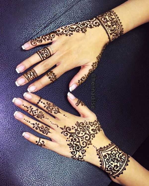 2. Curves and dots back hand henna
