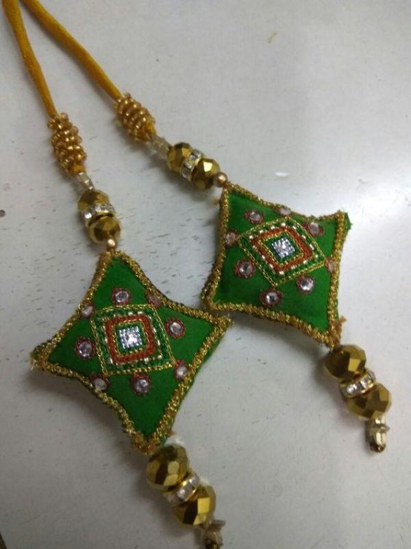 11.Green diamond shape tassels