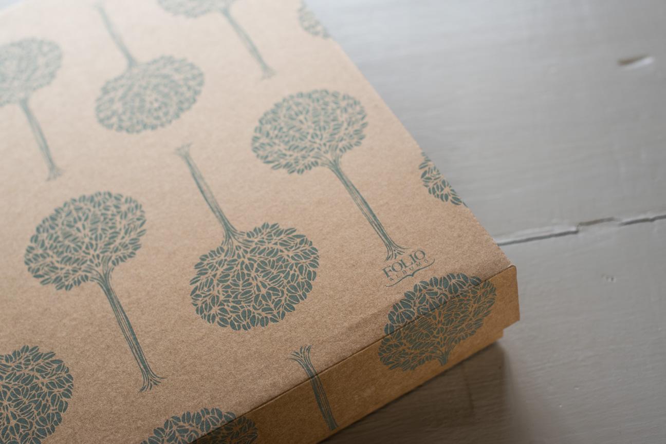 close up of folio wedding album logo and box