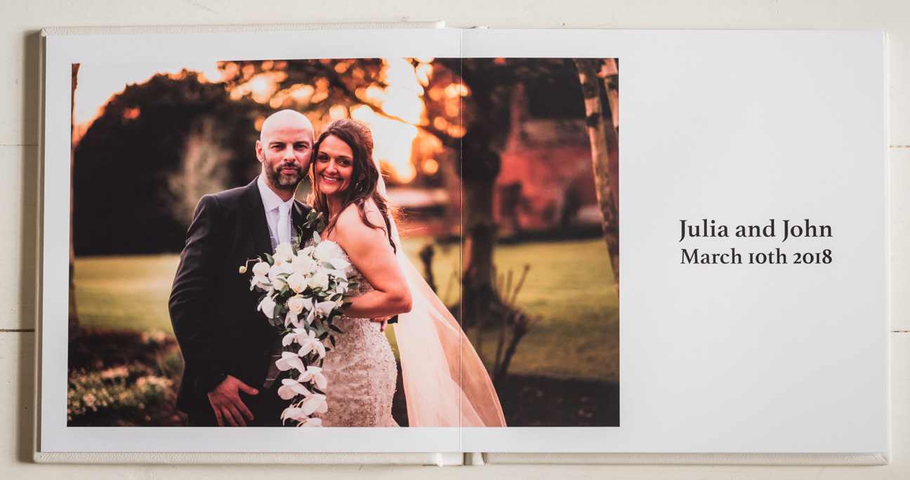 opening spread of wedding photo album showing couple's name and wedding date