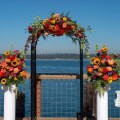 Flower decked wedding arbor on the pier share
