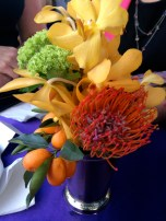 A flower arrangement on one of the standing cocktail tables.